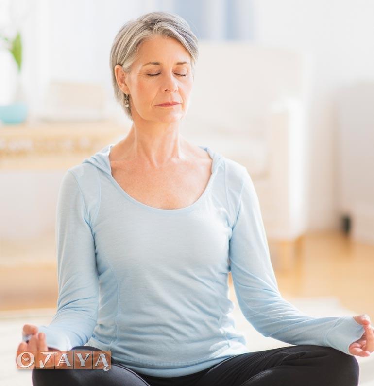 Woman practices OJAYA anti-aging meditation method