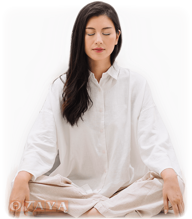 Young Asian woman course participant meditating blissfully