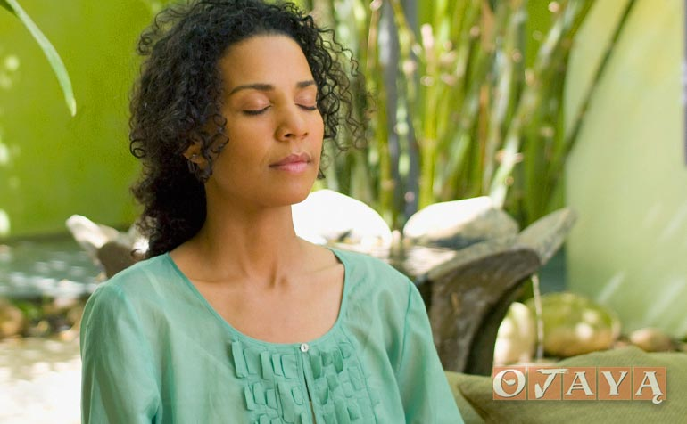 Woman meditating to remove anxiety