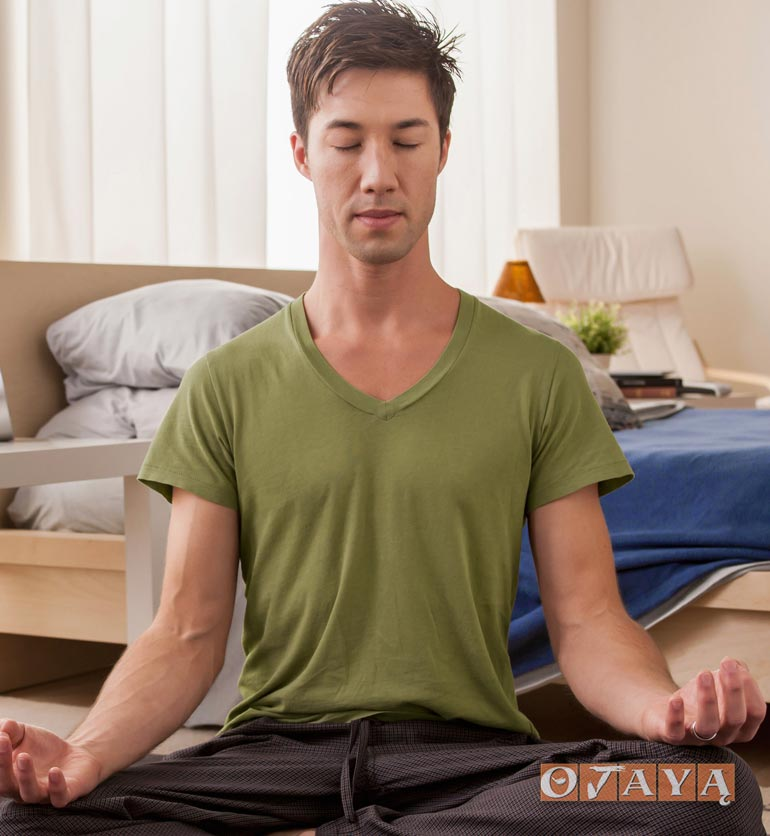 Young asian man meditating for energy and success.