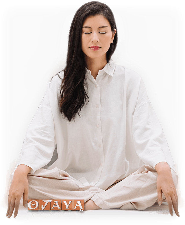 Deeply blissful Asian woman meditates with Ojaya technique